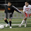 Monica Maschak - mmaschak@shawmedia.com<br /> Gebron Zamudio looks to pass in the first half against Rockford Jefferson on Wednesday, October 23, 2013. DeKalb shut out Rockford Jefferson 7-0.
