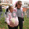 Rob Winner – rwinner@shawmedia.com<br /> <br /> Ellie Lochbaum (left), 11, walks with Kaitlyn Berntsen, 11, both of Sycamore, while carrying her pumpkin entry for the Sycamore Pumpkin Festival on the lawn of the DeKalb County Courthouse in Sycamore, Ill., on Wednesday, Oct. 23, 2013.