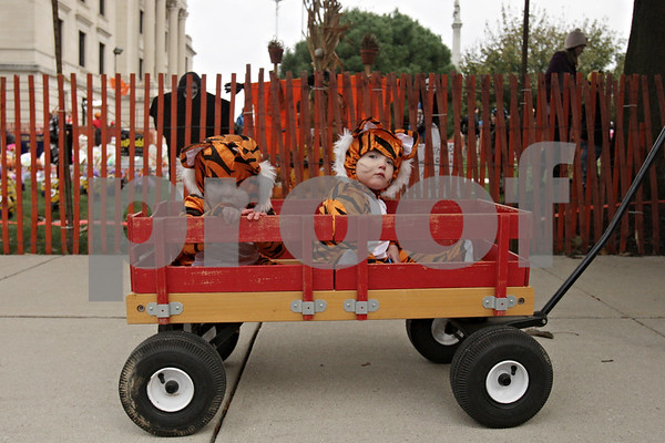 Rob Winner – rwinner@shawmedia.com<br /> <br /> Twins Andrew (left) and John Harris, 21 months, sit in a wagon after dropping off their pumpkin entries at the Sycamore Pumpkin Festival on Wednesday, Oct. 23, 2013.