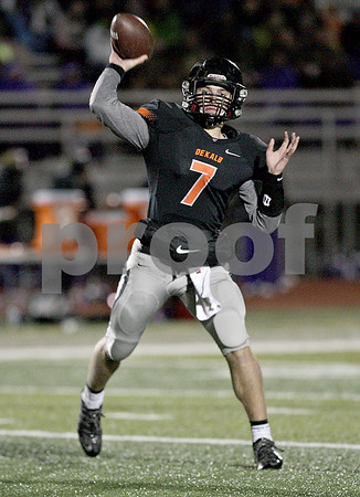 Monica Maschak - mmaschak@shawmedia.com<br /> Quarterback Jack Sauter passes to a teammate for a first down in the second quarter against Rochelle on October 25, 2013.