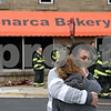 "Rob Winner – rwinner@shawmedia.com<br /> <br /> The owner of Monarca Bakery, Mario Ortiz, in DeKalb embraces his wife, Laura Ortiz, as DeKalb firefighters investigate the aftermath of a fire at the business on Tuesday, Oct. 22, 2013. ""I don't know how to take it right now,"" said Ortiz when asked about the fire. Ortiz opened the business about a month ago and added, ""it was a short dream."""