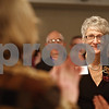 Monica Maschak - mmaschak@shawmedia.com<br /> Ann Lehan, of Lehan Drugs, receives a standing ovation as she is recognized as this year's Athena Award recipient at the 24th Annual Athena Reception at the Hopkins Park Terrace Room on Thursday, October 24, 2013. The Athena Award recognizes a person for business and professional accomplishments, community service, and for serving as a role model to encourage women to reach their full leadership potential.