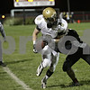 Rob Winner – rwinner@shawmedia.com<br /> <br /> Sycamore receiver Ben Niemann (8) is forced out-of-bounds after a reception during the first quarter in Yorkville, Ill., Friday, October 25, 2013.