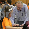 Rob Winner – rwinner@shawmedia.com<br /> <br /> Roger Christensen, a science instructor at Clinton Rosette Middle School in DeKalb, helps Madi Bicksler, 13, as Bicksler works on a science lab using a laptop on Monday, Oct. 21, 2013.