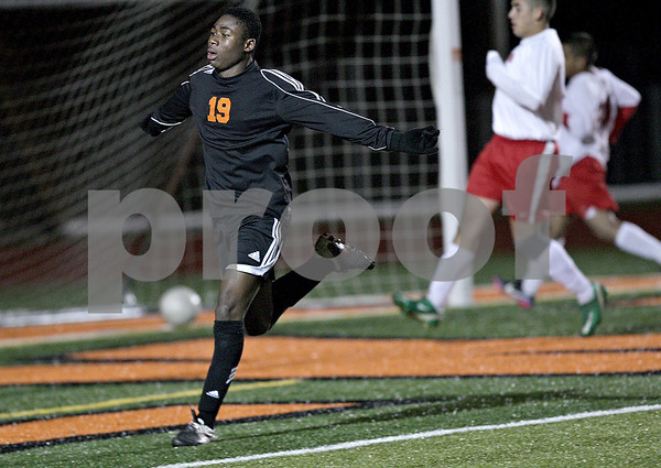 Monica Maschak - mmaschak@shawmedia.com<br /> Akim Suraji celebrates a goal in the second half against Rockford Jefferson on Wednesday, October 23, 2013. DeKalb shut out Rockford Jefferson 7-0.