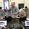 Rob Winner – rwinner@shawmedia.com<br /> <br /> Roger Christensen, an instructor at Clinton Rosette Middle School in DeKalb, helps Edgar Hernandez (left), 13, as Hernandez works on a science lab using a laptop on Monday, Oct. 21, 2013.