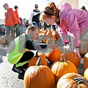 Monica Maschak - mmaschak@shawmedia.com<br /> Cayden Clay, 5, and Alise Goodman, 5, check out the selection at the free pumpkin distribution at American Family Insurance in Sycamore on Saturday, October 19, 2013. Theis Farm II brought in six tons of pumpkins for the occasion.