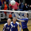 Monica Maschak - mmaschak@shawmedia.com<br /> Lexie Howie tips the ball over the net in the second set against Richmond-Burton on Tuesday, October 22, 2013. The Cogs lost the match.