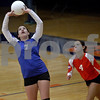 Monica Maschak - mmaschak@shawmedia.com<br /> Torri Bennett sets the ball for the next play in the second set against Richmond-Burton on Tuesday, October 22, 2013. The Cogs lost the match.