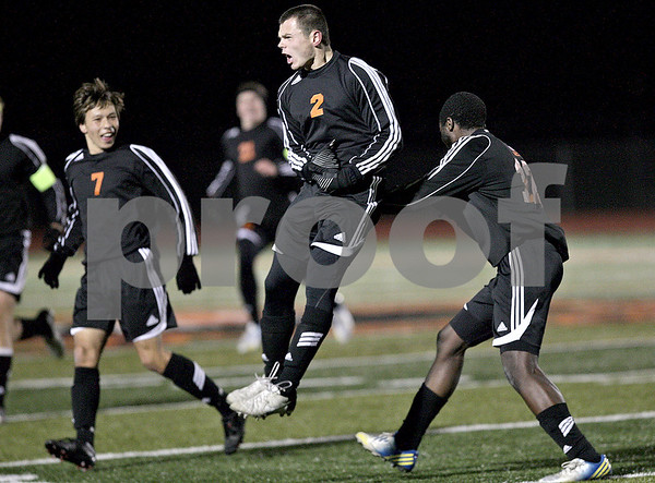 Monica Maschak - mmaschak@shawmedia.com<br /> Dylan Hottsmith jumps for joy after scoring a goal in the first half against Rockford Jefferson on Wednesday, October 23, 2013. DeKalb shut out Rockford Jefferson 7-0.