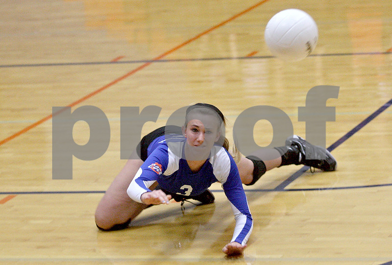 Monica Maschak - mmaschak@shawmedia.com<br /> Lindsey Sunderlage dives for a lost ball in the first set against Richmond-Burton on Tuesday, October 22, 2013. The Cogs lost the match.