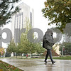 Rob Winner – rwinner@shawmedia.com<br /> <br /> Psychology major Nelsy Cruz is seen near the Holmes Student Center while making her way across the Northern Illinois University campus in DeKalb as the area saw its first snowfall of the season on Tuesday, Oct. 22, 2013.