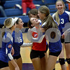 Monica Maschak - mmaschak@shawmedia.com<br /> The girls celebrate gaining the first point in the first set against Richmond-Burton on Tuesday, October 22, 2013. The Cogs lost the match.
