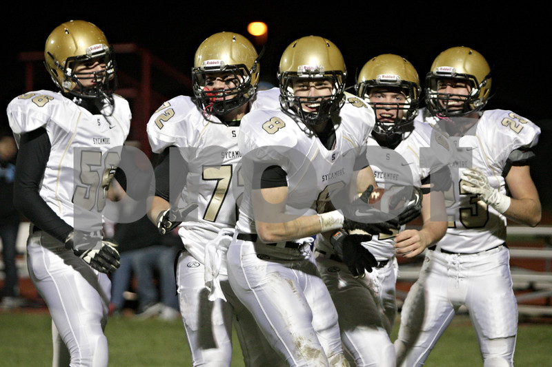 Rob Winner – rwinner@shawmedia.com<br /> <br /> Sycamore receiver Ben Niemann (8) celebrates with his teammates after his 31-yard touchdown reception during the first quarter in Yorkville, Ill., Friday, October 25, 2013.