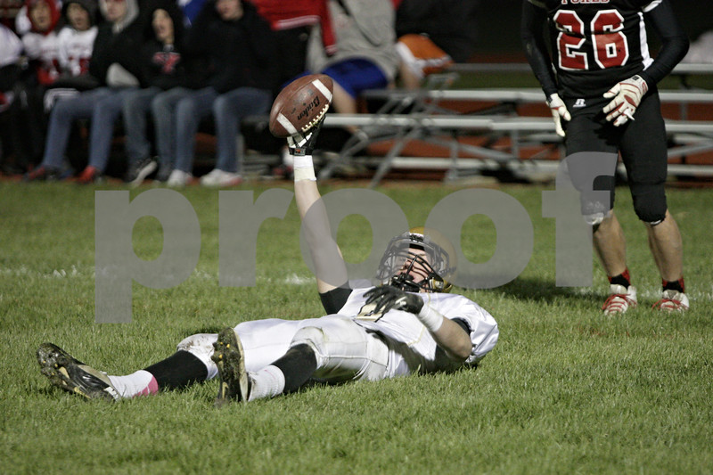 Rob Winner – rwinner@shawmedia.com<br /> <br /> Sycamore receiver Ben Niemann (8) holds up the football after a 31-yard touchdown reception during the first quarter in Yorkville, Ill., Friday, October 25, 2013.