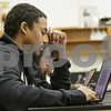 Rob Winner – rwinner@shawmedia.com<br /> <br /> Kevin Davis, 14, watches an instructional video on a laptop before conducting a science lab at Clinton Rosette Middle School in DeKalb on Monday, Oct. 21, 2013.