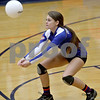 Monica Maschak - mmaschak@shawmedia.com<br /> Kylie Dalby bumps the ball in the second set against Richmond-Burton on Tuesday, October 22, 2013. The Cogs lost the match.