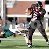Monica Maschak - mmaschak@shawmedia.com<br /> Quarterback Jordan Lynch shakes off a tackle in the second quarter against Eastern Michigan University on Saturday, October 26, 2013. The Huskies won 59-20.