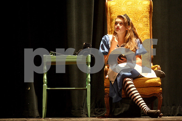 Monica Maschak - mmaschak@shawmedia.com<br /> Junior Veronica Sherman, as Alice, reads to the cat during an Alice in Wonderland rehearsal at DeKalb High School on Wednesday, October 30, 2013. The show starts this Friday.