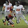 Monica Maschak - mmaschak@shawmedia.com<br /> Half back Eriq Torrey escapes a tackle in the first quarter against Batavia in the first round of the IHSA class 6A playoffs at Batavia High School on Friday, November 1, 2013.