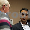 """Rob Winner – rwinner@shawmedia.com<br /> <br /> Eboo Patel (right) the author of """"Acts of Faith"""" speaks to Barney Scroeder of DeKalb during a reception at the Newman Catholic Student Center at Northern Illinois University in DeKalb, Ill., Tuesday, Oct. 29, 2013."""