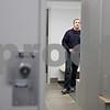 Rob Winner – rwinner@shawmedia.com<br /> <br /> Officer Chad McNett is seen inside the men's locker room at the new DeKalb Police Station as seen on Wednesday, Oct. 30, 2013.