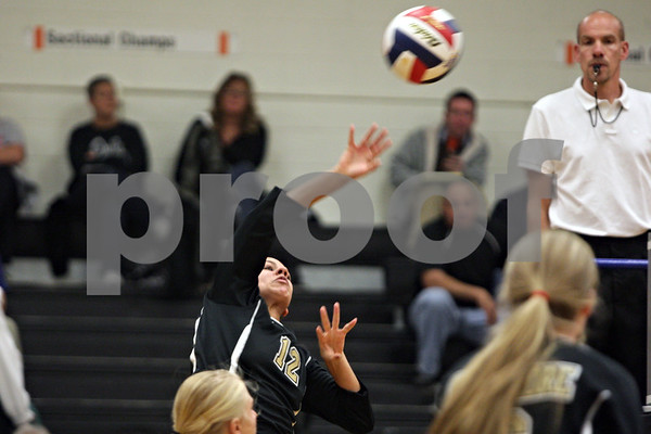 Rob Winner – rwinner@shawmedia.com<br /> <br /> Sycamore's Matelyn Hayes goes up for a ball in the second game against Sandwich during the Class 3A Sandwich Regional quarterfinal on Monday, October 28, 2013. Sycamore defeated Sandwich, 25-10 and 25-18.