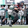 Monica Maschak - mmaschak@shawmedia.com<br /> Wide receiver Jacob Brinlee drags an opponent in the fourth quarter against Eastern Michigan University on Saturday, October 26, 2013. The Huskies won 59-20.