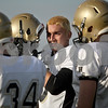 Monica Maschak - mmaschak@shawmedia.com<br /> Wide receiver Alec Kozak shows blonde hair from under his helmet at a practice. The team dawned bleached hair as an act of camaraderie in time for playoffs.