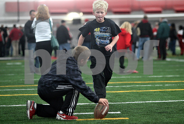 Monica Maschak - mmaschak@shawmedia.com<br /> William Halverson, 9, attempts to kick a field goal at the grand opening of the Kenneth and Ellen Chessick Practice Center on Northern Illinois University's campus on Saturday, October 26, 2013.