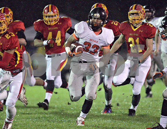 Monica Maschak - mmaschak@shawmedia.com<br /> Half back Dre Brown gets chased down field in the first quarter against Batavia in the first round of the IHSA class 6A playoffs at Batavia High School on Friday, November 1, 2013.