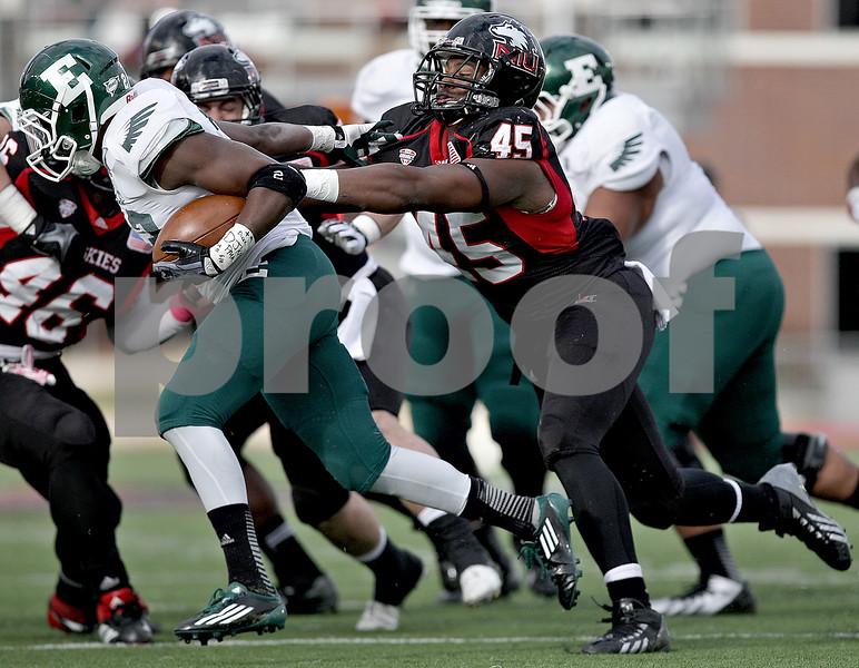 Monica Maschak - mmaschak@shawmedia.com<br /> Linebacker Boomer Mays grabs onto the ball carrier in the second quarter against Eastern Michigan University on Saturday, October 26, 2013. The Huskies won 59-20.
