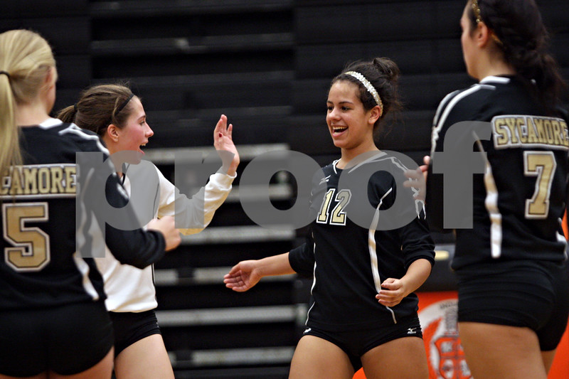 Rob Winner – rwinner@shawmedia.com<br /> <br /> Sycamore's Matelyn Hayes (12) celebrates after a point against Sandwich during the Class 3A Sandwich Regional quarterfinal on Monday, October 28, 2013. Sycamore defeated Sandwich, 25-10 and 25-18.