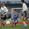 Rob Winner – rwinner@shawmedia.com<br /> <br /> Genoa-Kingston's Eric Garcia (center) passes the ball in the first half during the Class 1A State semifinal in Normal, Ill., on Friday, November 1, 2013. Herscher defeated G-K, 4-1.