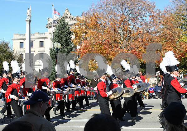 Erik Anderson - For the Daily Chronicle<br /> The Northern Illinois University Marching Band perform next to the DeKalb Court House heading East on W. State Street during the Sycamore Pumpkin Festival in downtown Sycamore on Sunday, October 27, 2013.