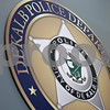 Rob Winner – rwinner@shawmedia.com<br /> <br /> A wall decoration of a badge is seen on the second floor at the new DeKalb Police Station on Wednesday, Oct. 30, 2013.