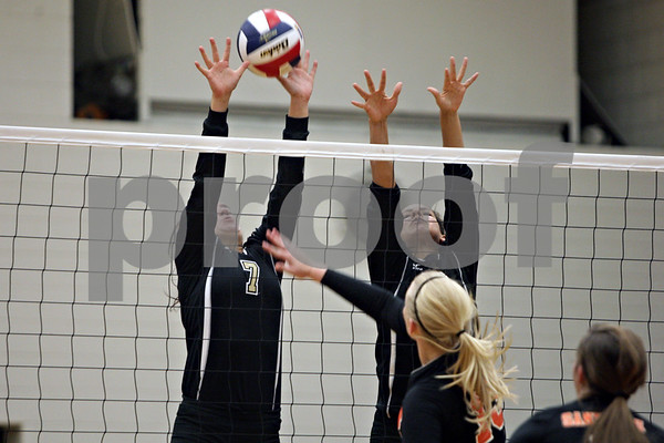 Rob Winner – rwinner@shawmedia.com<br /> <br /> Sycamore's Gabrielle Wenger (left) and Matelyn Hayes attempt to block a ball hit by Sandwich's Jessie Bivins in the second game during the Class 3A Sandwich Regional quarterfinal on Monday, October 28, 2013. Sycamore defeated Sandwich, 25-10 and 25-18.