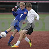 Rob Winner – rwinner@shawmedia.com<br /> <br /> Genoa-Kingston's Bobby Nay (7) and Herscher's Colin Lund go for a ball in the first half during the Class 1A State semifinal in Normal, Ill., on Friday, November 1, 2013. Herscher defeated G-K, 4-1.