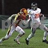 Monica Maschak - mmaschak@shawmedia.com<br /> Half back Eriq Torrey defends the ball in the first quarter against Batavia in the first round of the IHSA class 6A playoffs at Batavia High School on Friday, November 1, 2013.