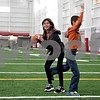Monica Maschak - mmaschak@shawmedia.com<br /> Olivia Burtel and brother Charlie Burtell, of South Barrington, play catch with their dad at the grand opening of the Kenneth and Ellen Chessick Practice Center on Northern Illinois University's campus on Saturday, October 26, 2013.