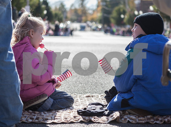 Erik Anderson - For the Daily Chronicle<br /> Ilana Holtz, 5, and brother Timothy, 8, hold American flags while waiting for the Sycamore Pumpkin Festival to start while in downtown Sycamore on Sunday, October 27, 2013.