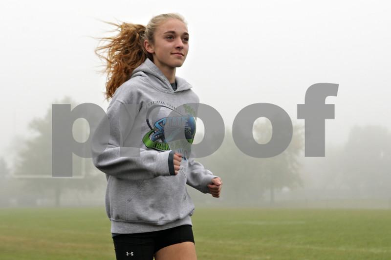 Rob Winner – rwinner@shawmedia.com<br /> <br /> Senior Maggie Lalowski runs the track at Sycamore High School on Wednesday, Oct. 30, 2013.