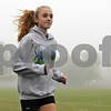 Rob Winner – rwinner@shawmedia.com<br /> <br /> Senior Maggie Lalowski runs the track at Sycamore High School on Wednesday, Oct. 30, 2013.