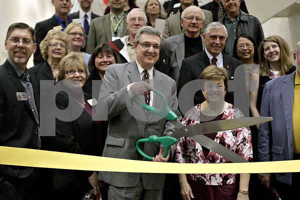 Monica Maschak - mmaschak@shawmedia.com<br /> Kishwaukee College President Dr. Thomas Choice cuts the ribbon at the open house for the new science wing on campus on Wednesday, October 30, 2013.