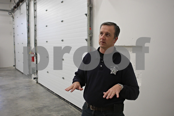 Rob Winner – rwinner@shawmedia.com<br /> <br /> Officer Chad McNett describes the function of the sally port and it's features at the new DeKalb Police Station as seen on Wednesday, Oct. 30, 2013.