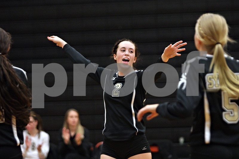 Rob Winner – rwinner@shawmedia.com<br /> <br /> Emily Young (2) celebrates after Sycamore defeated Sandwich in the first game during the Class 3A Sandwich Regional quarterfinal on Monday, October 28, 2013. Sycamore defeated Sandwich, 25-10 and 25-18.