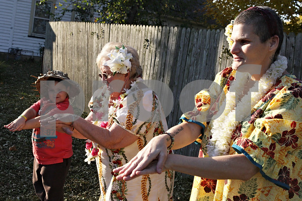 Rob Winner – rwinner@shawmedia.com<br /> <br /> (From right to left) Colleen Hass, Kitty Murrell and Murrell's great-grandson Mikey Hernandez, 6, dance in a hawaiian style outside Murrell's home in Sandwich, Ill., Monday, October 28, 2013. Hass and Murrell have known each other for 46 years and haven't seen each other for 39. Murrell, who was a dance teacher, taught Hass how to ballet, tap, jazz and Hawaiian dance.