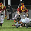 Monica Maschak - mmaschak@shawmedia.com<br /> Offensive tackle Zachary Tate clears the way for running back Anthony Scaccia in the first quarter against DeKalb in the first round of the IHSA class 6A playoffs at Batavia High School on Friday, November 1, 2013.