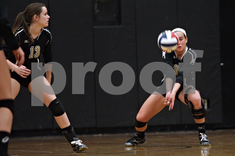 Rob Winner – rwinner@shawmedia.com<br /> <br /> Sycamore's Mallory Wolf bumps a ball in the second game against Sandwich during the Class 3A Sandwich Regional quarterfinal on Monday, October 28, 2013. Sycamore defeated Sandwich, 25-10 and 25-18.