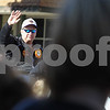 Erik Anderson - For the Daily Chronicle<br /> Pumpkin Festival Grand Marshal, Brian Bickner, waves to onlookers while heading East on W. State Street during the Sycamore Pumpkin Festival in downtown Sycamore on Sunday, October 27, 2013.